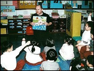Andrew Orme reading in his son's kindergarten